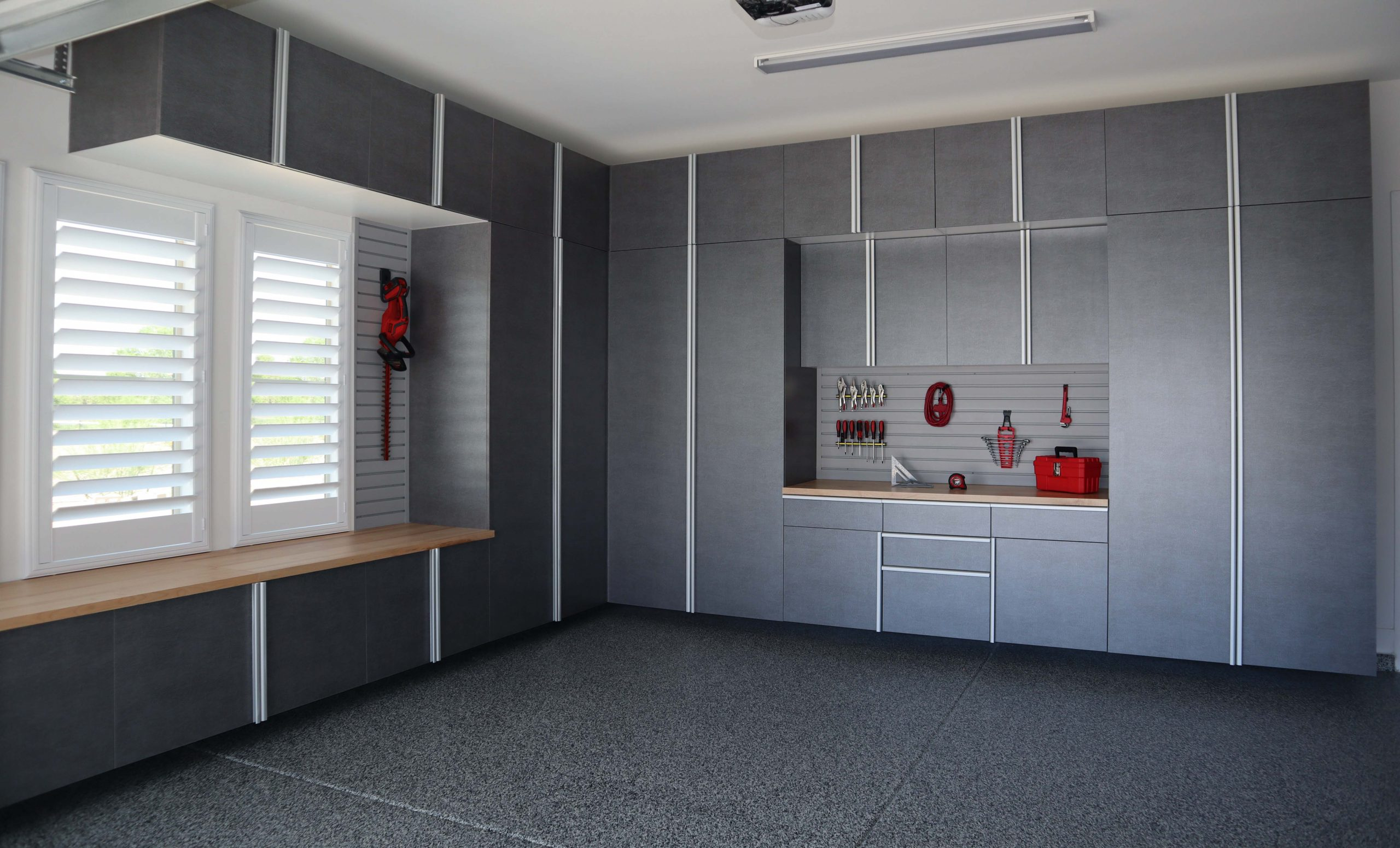 Pewter Cabinets with Butcher Block Countertop and Grey Slatwall Angle
